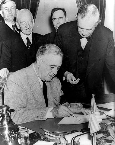 Roosevelt signs declaration of war