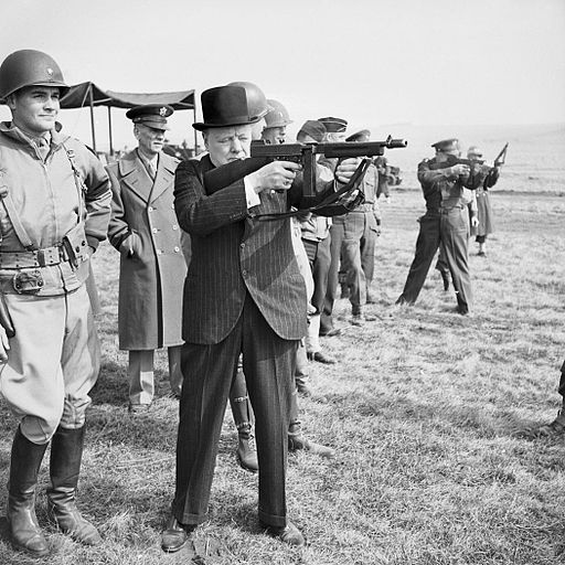 Winston Churchill firing tommy gun